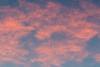 A few purple clouds up high.