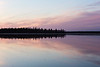 The Moose River at Moosonee, Ontario before sunrise. South end of Butler Island. Clouds reflected in the water.