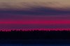 Looking across the Moose River from Moosonee before sunrise. Narrow band of pink.