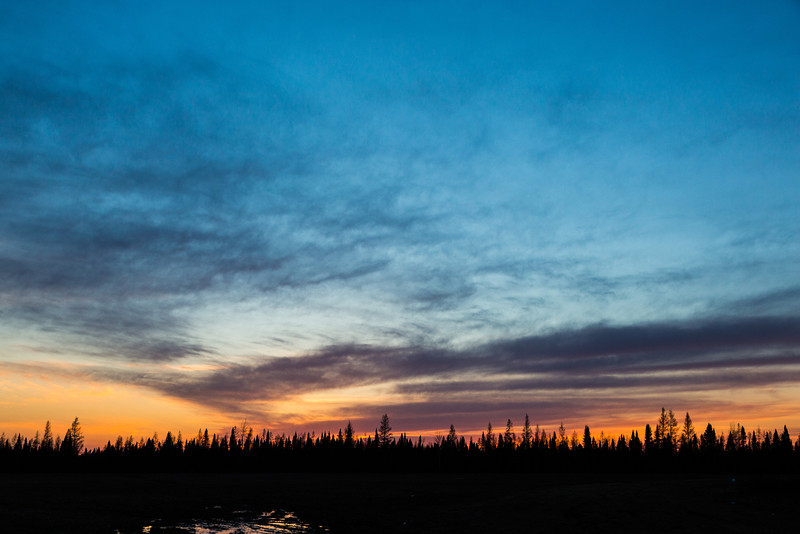 Looking west around sunset from Butcher Road railway crossing in Moosonee.