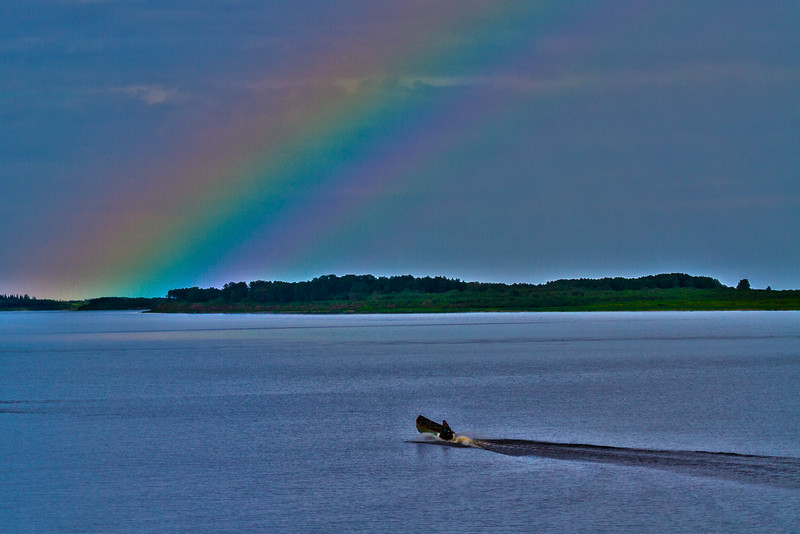 Partial rainbow down the Moose River with canoe. PS two layrs mult, HDR tone more saturated.