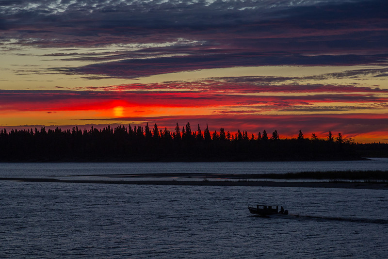 Skies over the Moose River before sunrise at Mosonee. Taxi boat headed to Moose Factory.