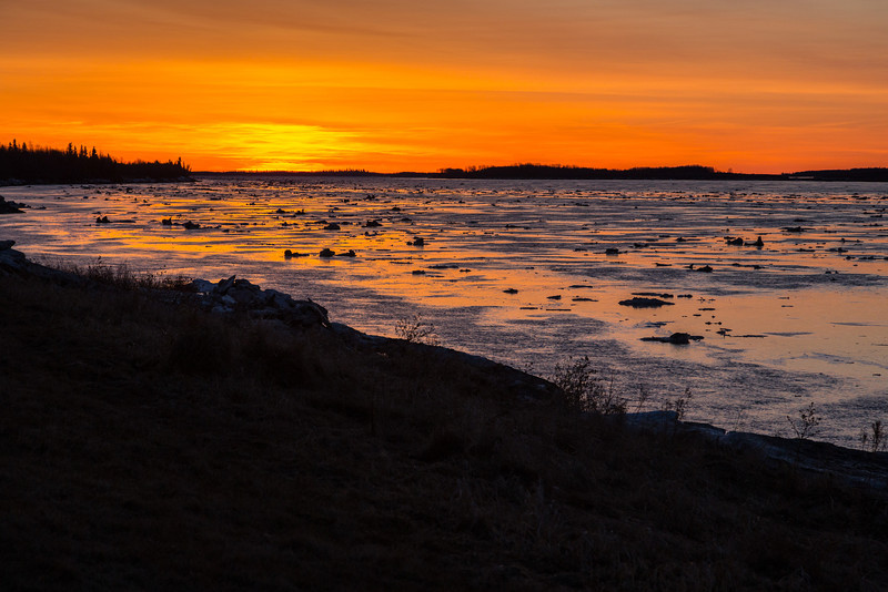 Ice floating down the Moose River at sunrise.