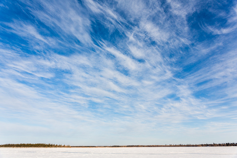 Thin clouds over the Moose River at Moosonee.