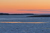 Looking up the Moose River towards hydro towers around sunset.