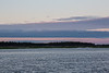 Clouds over the Moose River at sunrise at Moosonee, Ontario.