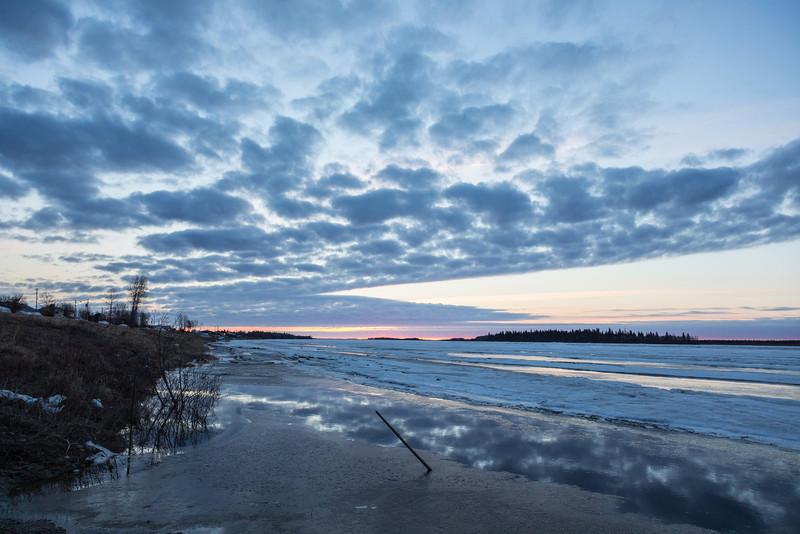 Moose River shoreline at Moosonee. Looking down river at sunrise.