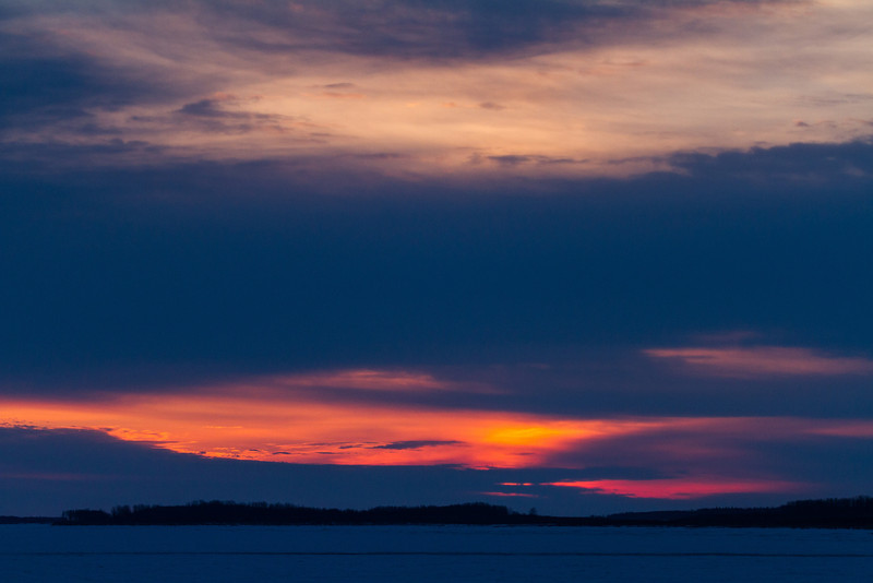 Cloudy sunrise looking down the Moose River from Moosonee.