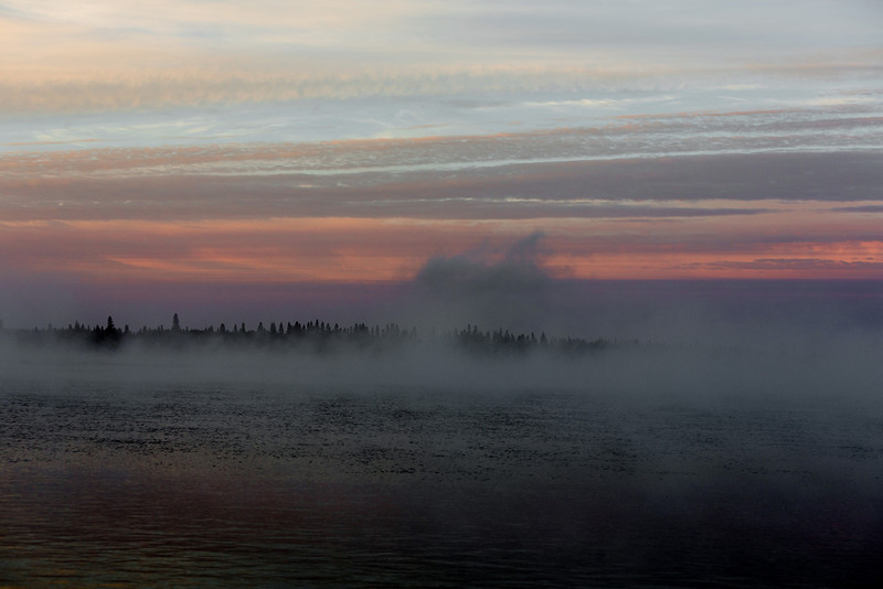 Across the Moose River on a foggy morning at sunrise.