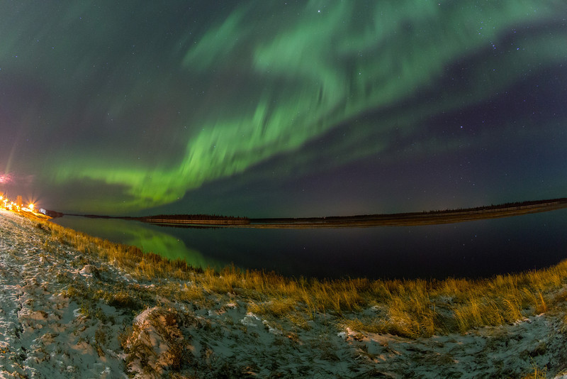 Aurora Borealis or Northern Lights over Moosonee and the Moose River.