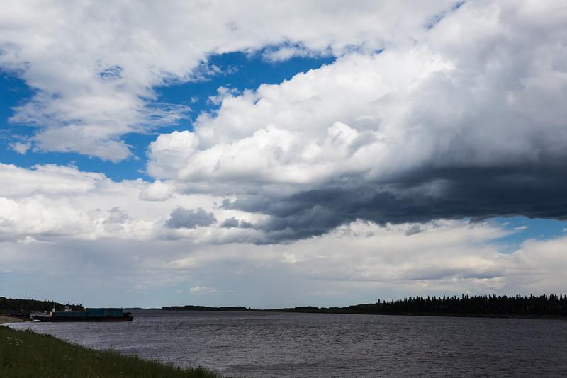 Clouds over the Moose River at Moosonee, Ontario.