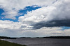 Clouds over the Moose River at Moosonee, Ontario.