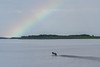 Partial rainbow down the Moose River with canoe.