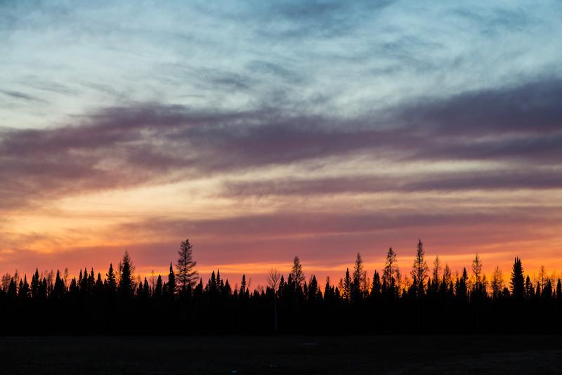 Looking west around sunset from Butcher Road railway crossing in Moosonee.