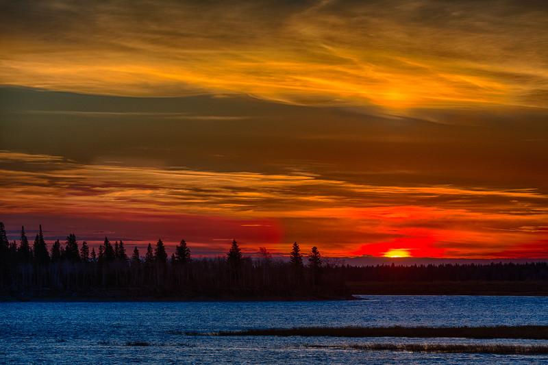 Sunrise across the Moose River from Moosonee. HDR efx dark.