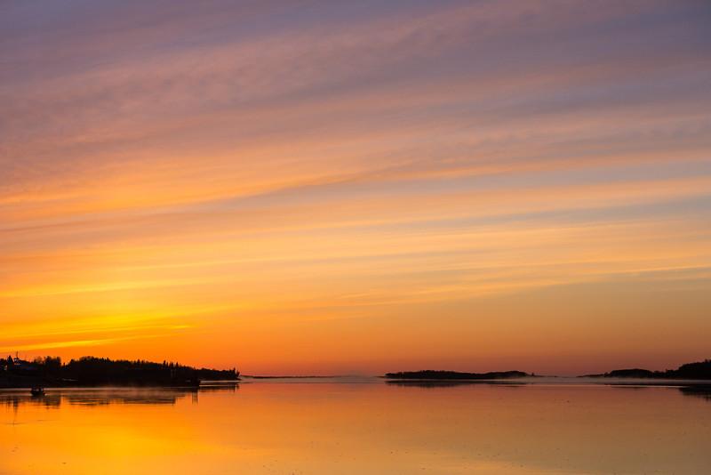 Just before sunrise, looking down the Moose River at Moosonee.