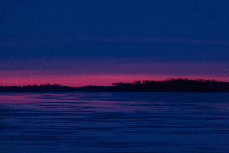 Looking towards north end of Butler Island in the Moose River from Moosonee before sunrise. Clouds over thin streak of colour.