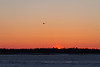 Helicopter heading from Moose Factory to Moosonee at sunrise.
