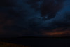 Looking across the Moose River. Clouds moving during time exposure. Lights of Moose Factory colour the sky to the east.