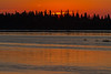 Sun coming up over Butler Island in the Moose River at Moosonee.