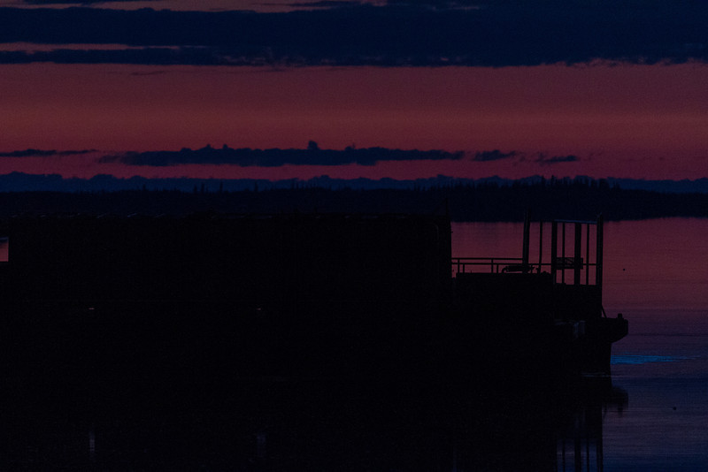 Looking past barges on the Moose River before sunrise at Moosonee.