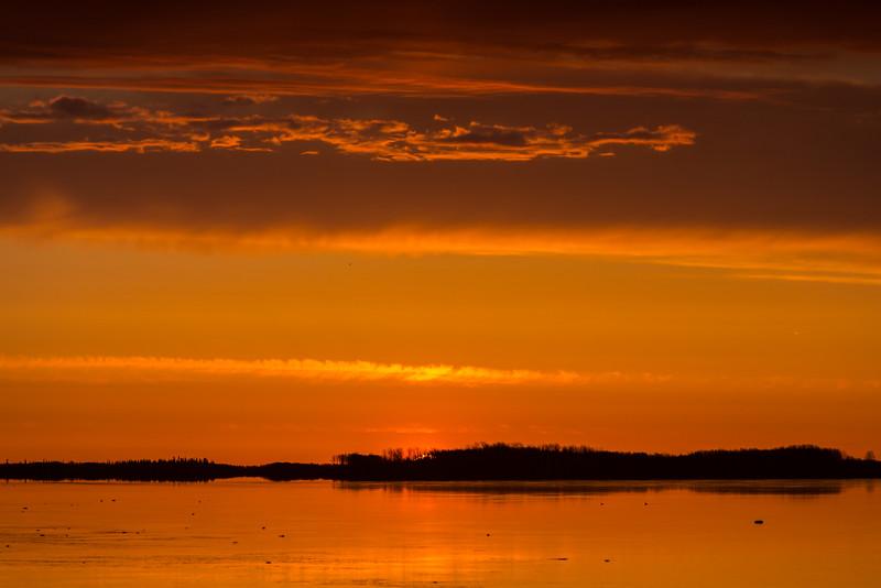 Sunrise down the Moose River from Moosonee.