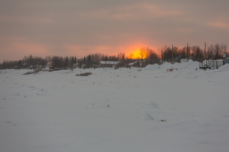 Revilon Road seen from the Moose River around sunset.