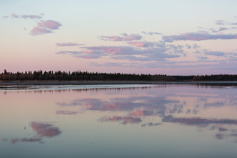 Clouds reflected in the Moose River at Moosonee just after dawn.
