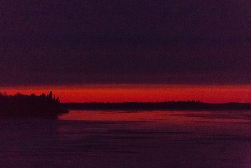 Looking down the Moose River from Moosonee one hour before before sunrise. Clouds over thin streak of colour. Noise reduction 25/50. Brighter one f stop.