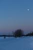 Moon high above Revillon Road around sunrise.