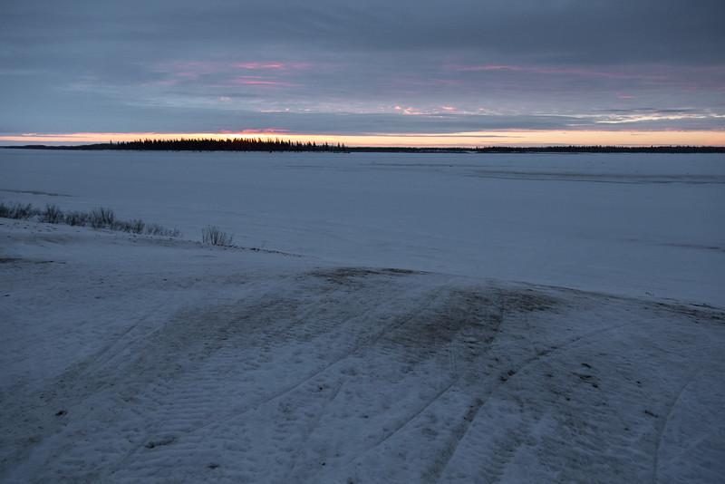 Edge of the Moose River at sunrise at Moosonee.