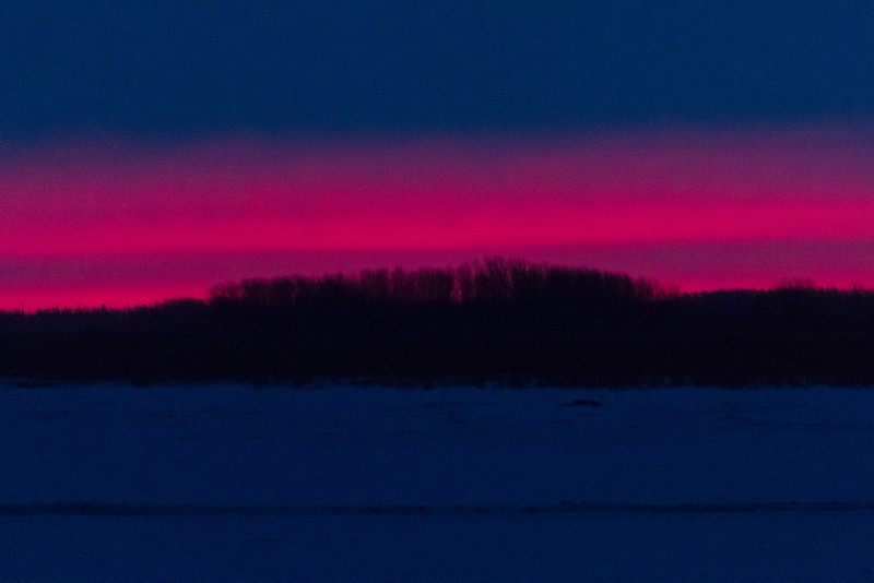 A cloudy, wet and windy morning. The cloud cover lifted a bit to the northeast to reveal some colour before sunrise.