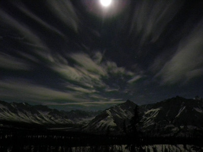 Experimenting here.  Taken from a loop pullout at about Mile 115.5 on the Glenn Hwy.  A full moon illuminates the Chugach Mts in this 1.74 second slow exposure shot at f/2.8 and ISO 800.  Photo taken at 1:17 AM 1/31/2010.