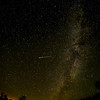 Bright Green Meteor in center; aircraft strobe at right