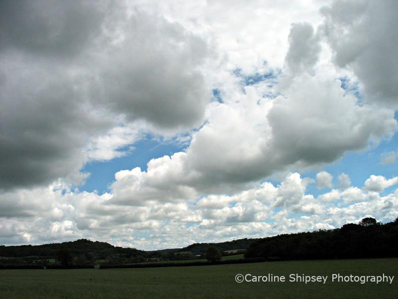 Cumulus, Stratocumulus,  poss Altocumulus over Dinder, near Wells, Somerset.