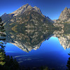 The reflection of the Tetons off of Jenny Lake. Taken Sept, 2009.