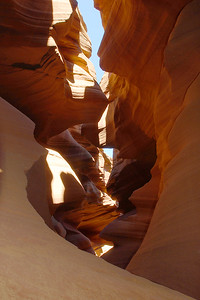 © Joseph Dougherty. All rights reserved.   Flowing red stone walls, carved by eons of rushing water.   Lower Antelope Canyon, Navajo Nation Lands, AZ.