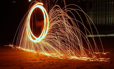 20 second exposure.  Flaming steel wool in a wire whisk tied to a rope and swirled around...