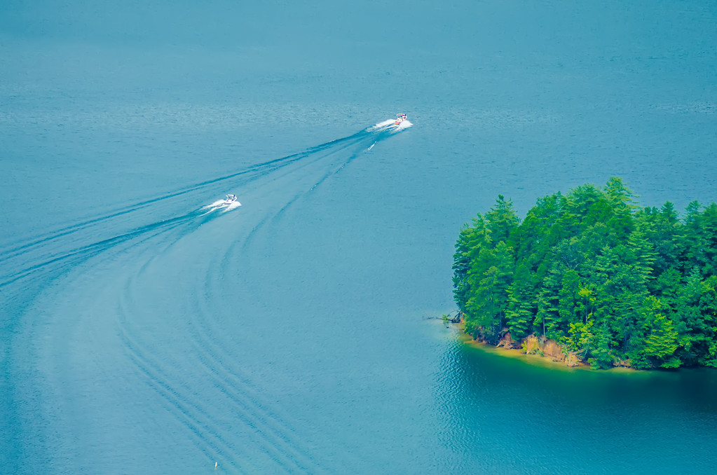 birds eye view of boats on a lake