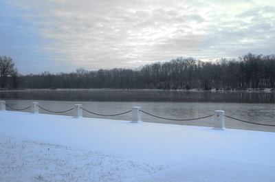 Snow along the water in color
