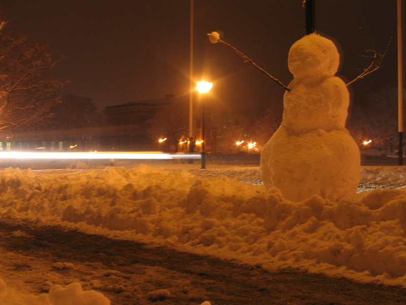 These snowpeople were inspired by numerous Calvin and Hobbes comics.<br /> <br /> Josh's snowman, built around the streetlight and tossing snowballs at the passing cars.