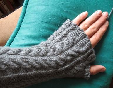 Cashmere cabled fingerless mitts.  One done, one to go.