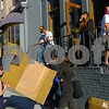 People use a piece of cardboard to project the sun as they gather in front of Henry's pub at the Hotel Durant to watch the annular solar eclipse in Berkeley, California on Sunday, May 20, 2012. Photo: David Yee ©2012