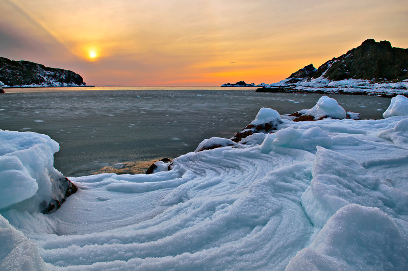 Rough seas and pounding waves push snow and ice onshore near Sea Breeze Park, Twillingate, Newfoundland.
