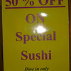 Sign outside Mikado--sushi is really good and really inexpensive--their explanation is 'we blamed the economic'.  Awesome.