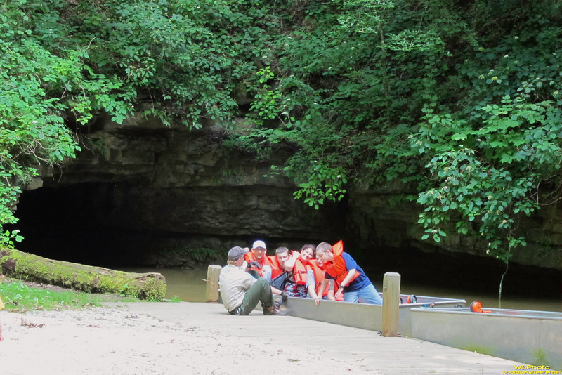 """Twin Caves<br /> <br /> This is the group before us returning from the Twin Caves boat tour. This shows the north entry into Twin Caves. Evidently Twin Caves used to be one big cave until a sinkhole collapsed and opened it up into two separate caves (I think that's what the tour guide said anyway).<br /> <br /> Boat tours are offered into Northern Twin cave located in Spring Mill State Park. The tours last about 20 minutes and go about 600 feet back and turn around.<br /> <br /> Twin Caves is open daily from 9 a.m. to 5 p.m. Cost is $3 for adults and $1 for children under 11 years of age. Tours run on the half-hour; no advance registrations are accepted (sign up on day of tour only). No children under 3 years of age are allowed on the tour. <br /> <br /> Twin Caves relate links:<br /> <br />  <a href=""""http://en.wikipedia.org/wiki/Twin_caves"""">http://en.wikipedia.org/wiki/Twin_caves</a><br /> <br />  <a href=""""http://www.in.gov/dnr/parklake/2968.htm"""">http://www.in.gov/dnr/parklake/2968.htm</a>"""