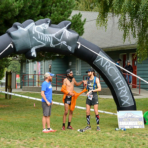 a few famous runners near the finish line of the Squamish 50 race (race director Gary Robbins, Michael Versteeg, Michael Wardian)