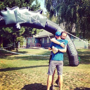 hugging the race director after finishing the Squamish 50k