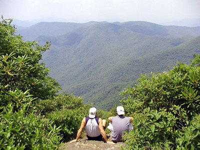 Father and son section hikers we met along the way sitting and taking in the view from Standing Indian Summit along the A.T. Southern Nantahala Wilderness, NC
