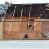 The roof was torn from one home west of St. Elmo during Sunday's tornado.